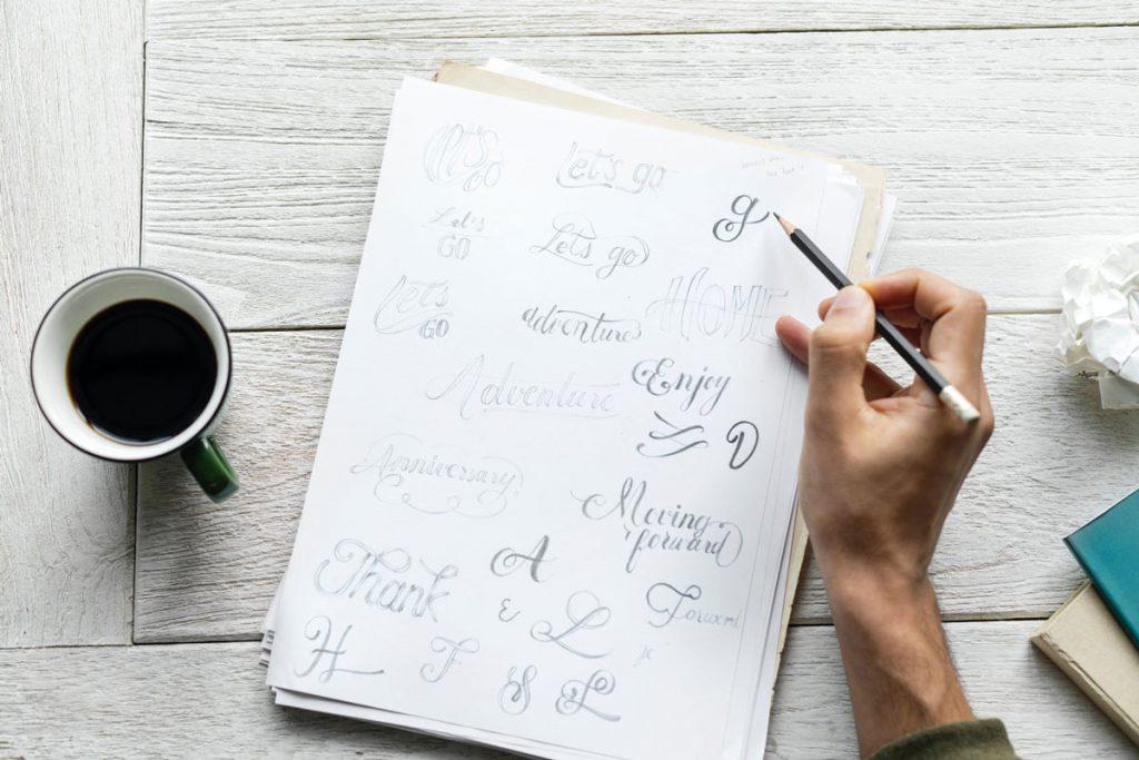 Image of person designing logos